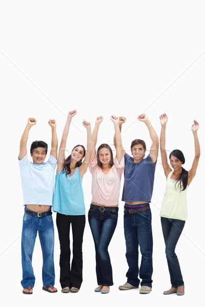Customers raising their arms against white background Stock photo © wavebreak_media