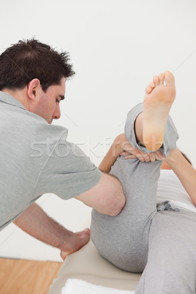 Chiropraticien jambe femme chambre homme Photo stock © wavebreak_media
