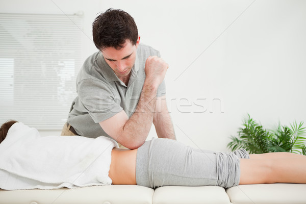 Man pressing the back of a woman with his elbow in a room Stock photo © wavebreak_media
