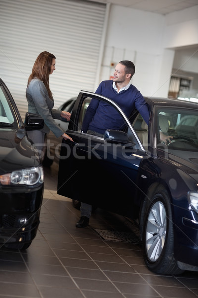 Businesswoman opening car door in a garage Stock photo © wavebreak_media