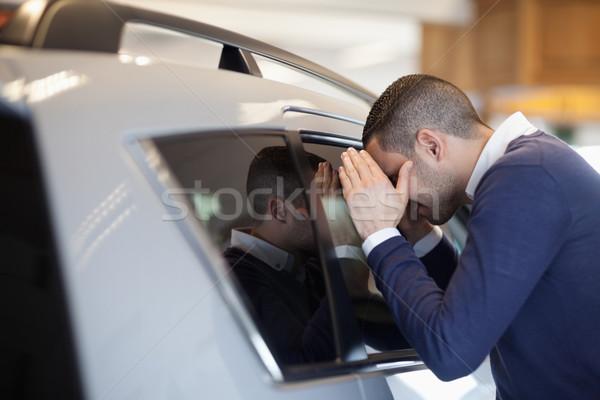 Client looking inside a car in a garage Stock photo © wavebreak_media