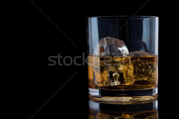 Tumbler glass with whiskey against a black background Stock photo © wavebreak_media