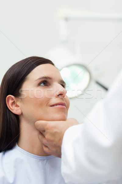 Woman patient being auscultated by a doctor in an examination Stock photo © wavebreak_media