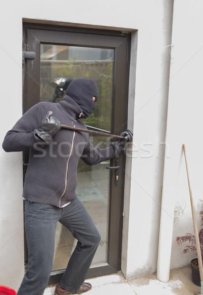 Burglar breaking door from outside with crow bar Stock photo © wavebreak_media