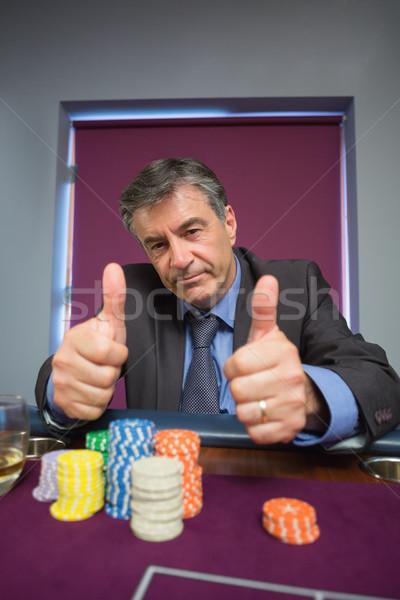 Hombre ruleta mesa casino vidrio Foto stock © wavebreak_media