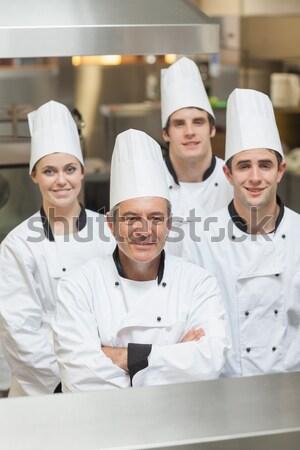 Mosolyog csapat séfek áll konyha munka Stock fotó © wavebreak_media