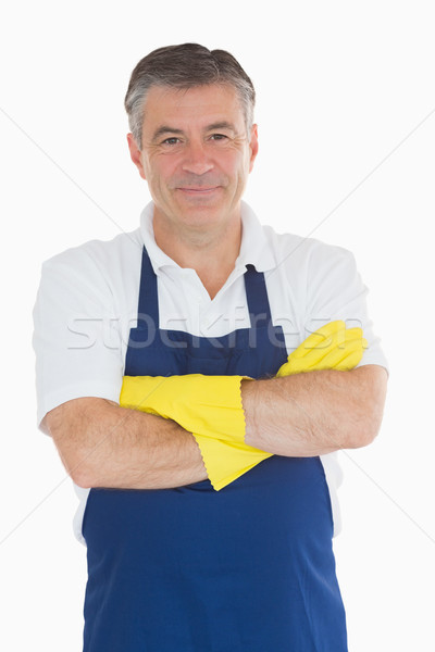 Man with arms crossed in blue apron wearing rubber gloves Stock photo © wavebreak_media
