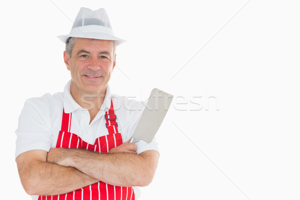 Stock photo: Smiling butcher with meat cleaver and crossed arms
