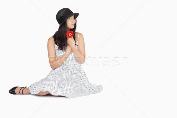 Woman sitting on the floor looking away wearing a dress and a hat Stock photo © wavebreak_media