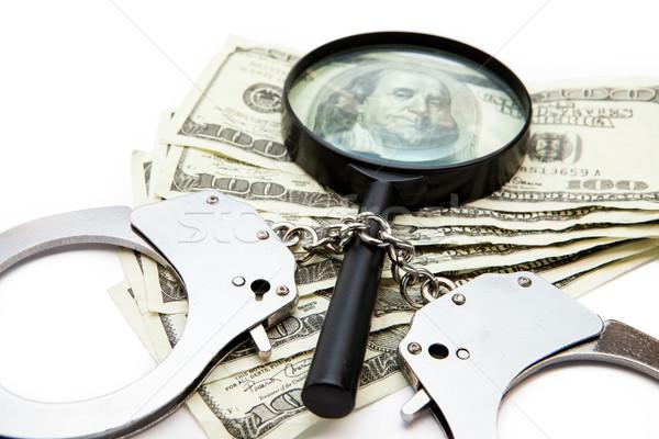 Handschellen Dollar Rechnungen Lupe weiß Geld Stock foto © wavebreak_media