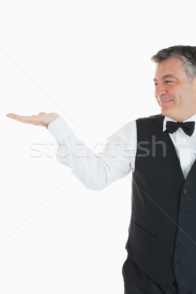 Smiling waiter holding something in front of camera Stock photo © wavebreak_media