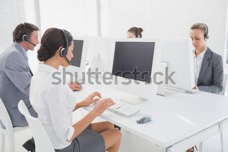Imprenditrice utilizzando il computer portatile conferenza sorriso computer riunione Foto d'archivio © wavebreak_media