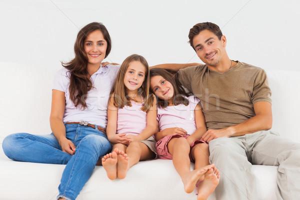 Bonitinho família sessão sofá sala de estar mulher Foto stock © wavebreak_media