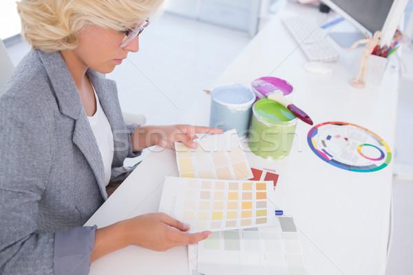 Serious interior designer looking at colour charts  Stock photo © wavebreak_media
