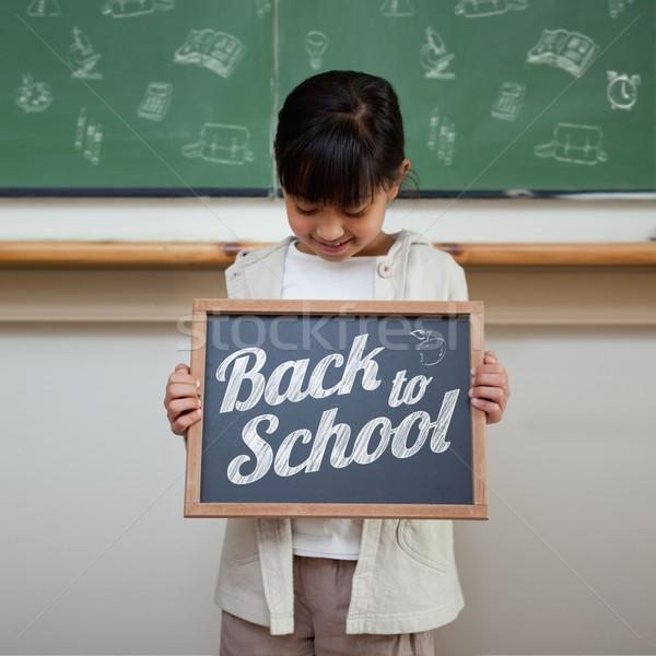 összetett kép vissza az iskolába üzenet aranyos mutat Stock fotó © wavebreak_media