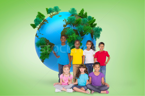 Composite image of elementary pupils smiling Stock photo © wavebreak_media