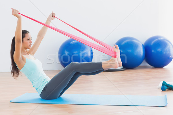 Sporty woman with exercise band in fitness studio Stock photo © wavebreak_media