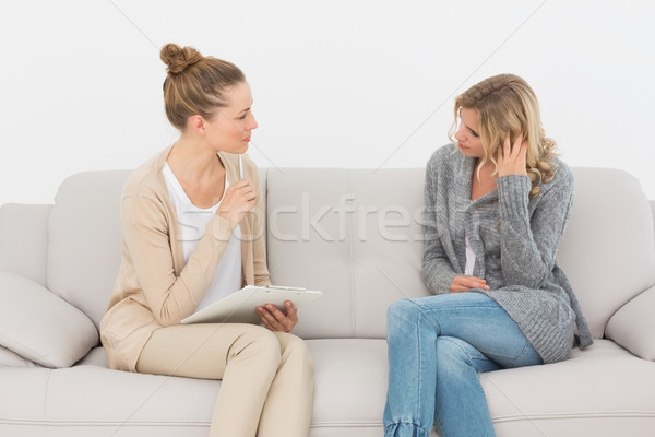 Upset woman talking to her therapist on the couch Stock photo © wavebreak_media