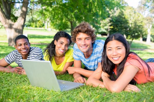 студентов ноутбука кампус портрет университета трава Сток-фото © wavebreak_media