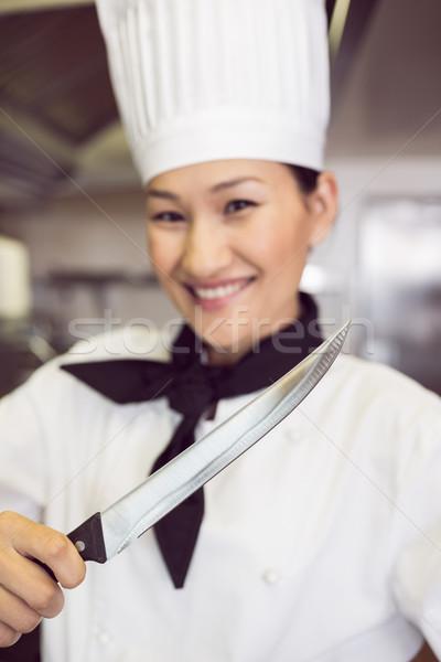 Sonriendo femenino cocinar cuchillo cocina Foto stock © wavebreak_media