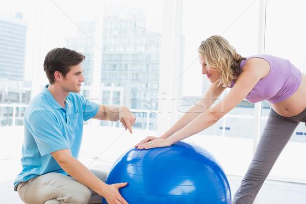 Boldog terhes nő testmozgás edző labda stúdió Stock fotó © wavebreak_media