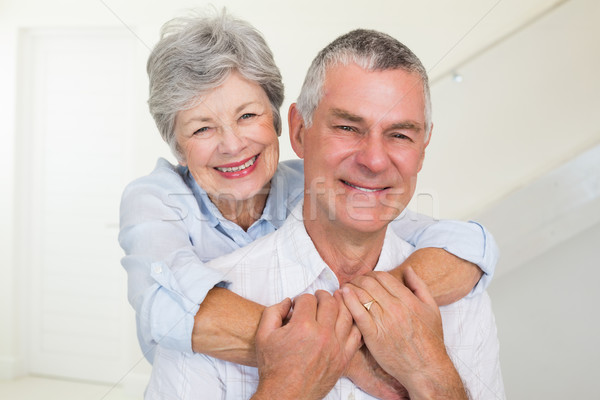 Affectionate retired couple smiling at camera Stock photo © wavebreak_media