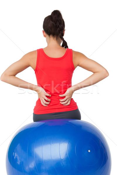 Widok z tyłu dopasować młoda kobieta posiedzenia wykonywania piłka Zdjęcia stock © wavebreak_media