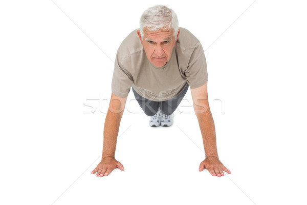 Portrait of a senior man doing push ups Stock photo © wavebreak_media