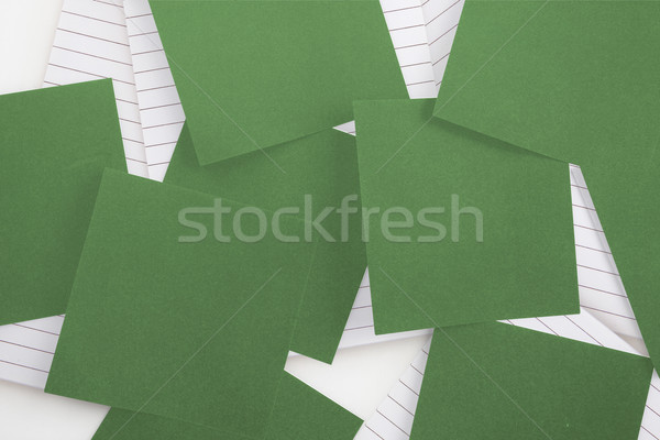 Green paper strewn over notepad Stock photo © wavebreak_media