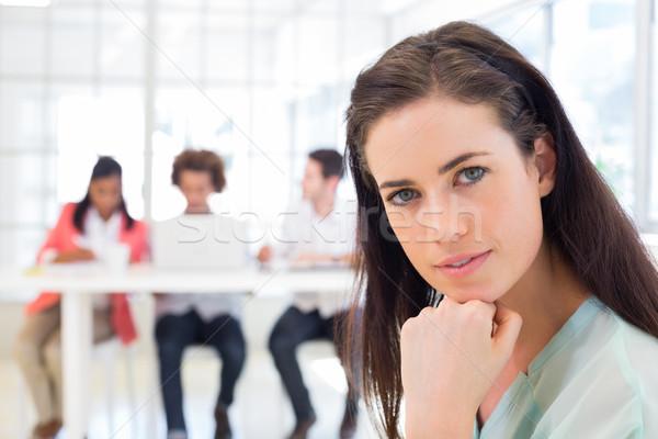 Aantrekkelijk kantoormedewerker denken naar camera kantoor Stockfoto © wavebreak_media