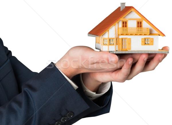 бизнесмен миниатюрный дома модель белый Сток-фото © wavebreak_media