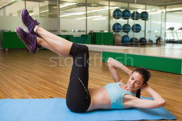 Caber morena sentar-se fitness estúdio ginásio Foto stock © wavebreak_media