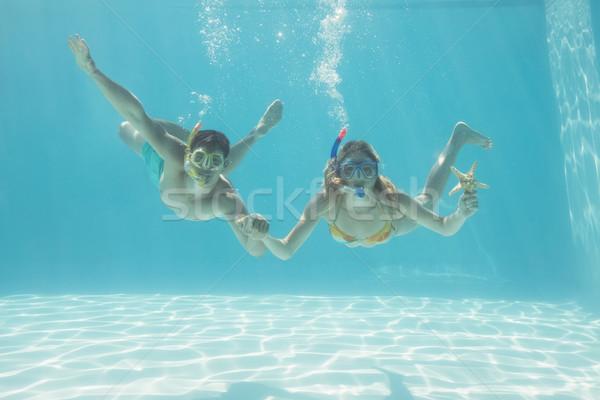 Aranyos pár vízalatti úszómedence búvárpipa tengeri csillag Stock fotó © wavebreak_media
