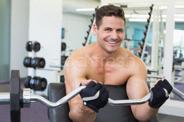 Sin camisa sonriendo pesado barra con pesas Foto stock © wavebreak_media