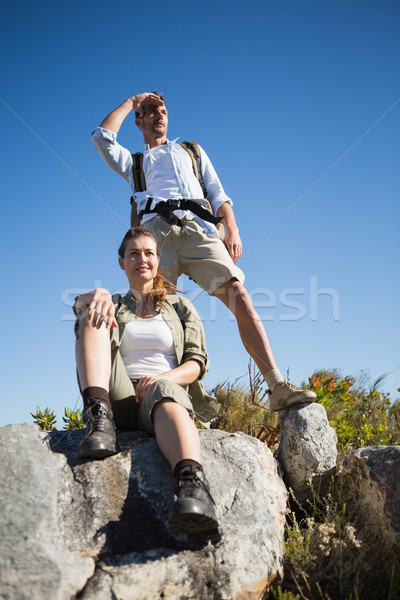 Hiking couple looking out over mountain terrain Stock photo © wavebreak_media