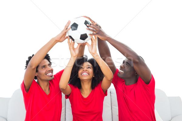 Boldog futball szurkolók piros magasra tart labda Stock fotó © wavebreak_media