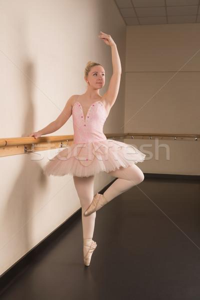 Beautiful ballerina standing en pointe holding barre Stock photo © wavebreak_media