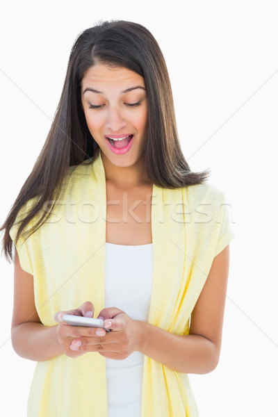 Shocked casual woman reading a text Stock photo © wavebreak_media