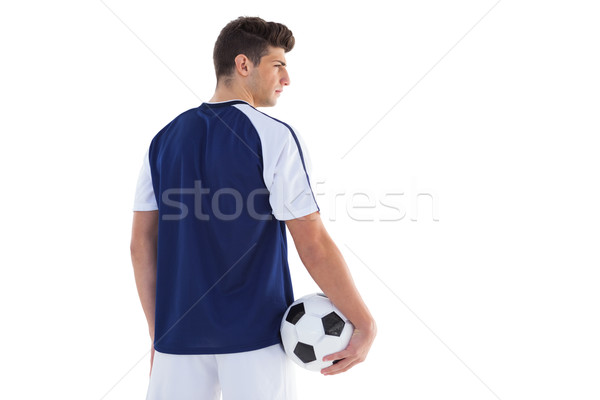 Football player in blue jersey holding ball Stock photo © wavebreak_media
