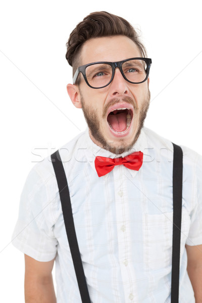 Nerdy businessman shouting with mouth open Stock photo © wavebreak_media