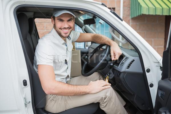 Entrega motorista sorridente câmera tem fora Foto stock © wavebreak_media