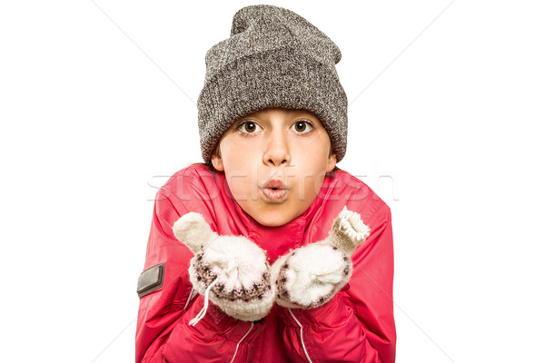 Wrapped up little girl blowing over hands Stock photo © wavebreak_media