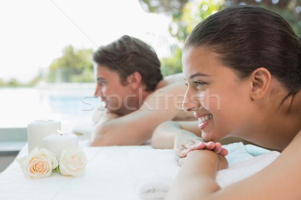 Coppia massaggio tavola spa centro vista laterale Foto d'archivio © wavebreak_media