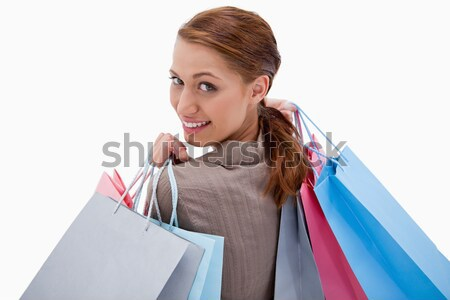 Happy brunette with shopping bags and gifts Stock photo © wavebreak_media