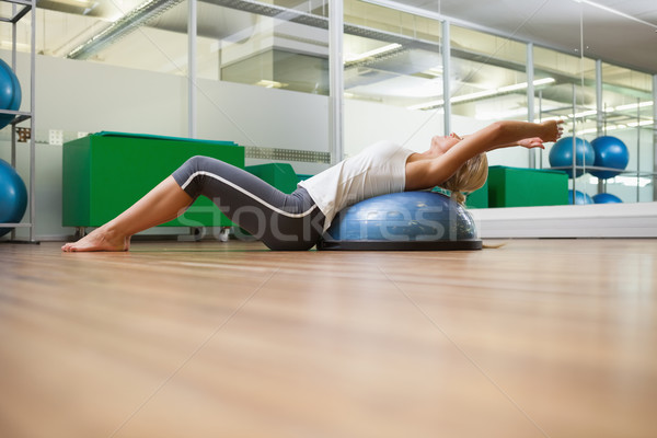 Side view of woman stretching her back in fitness studio Stock photo © wavebreak_media