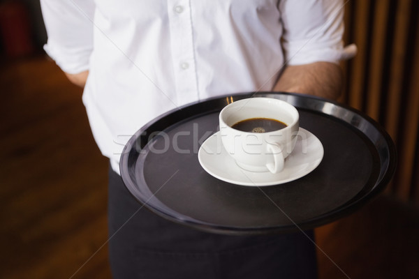 Waiter holding tray with coffee cup Stock photo © wavebreak_media
