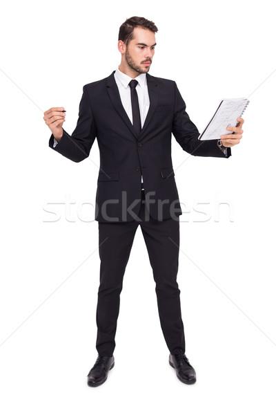 Fókuszált üzletember tart toll notebook fehér Stock fotó © wavebreak_media