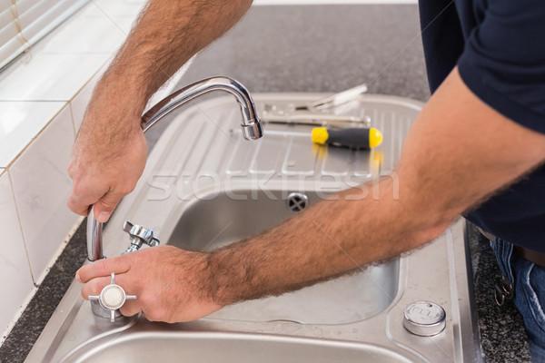 Man fixing tap with pliers Stock photo © wavebreak_media