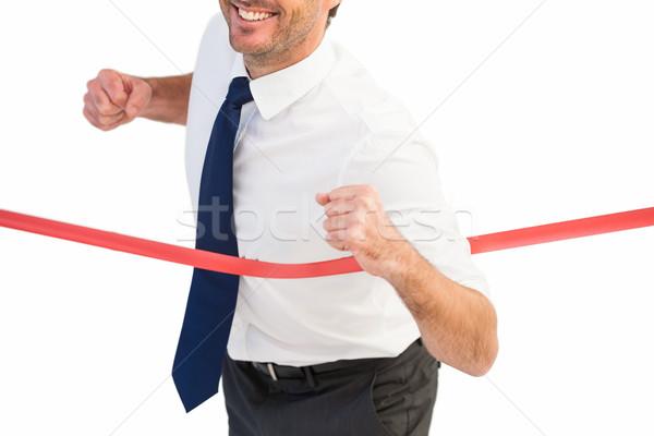 Businessman smiling and crossing the line Stock photo © wavebreak_media