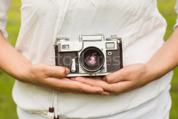 Mid section of woman holding retro camera Stock photo © wavebreak_media